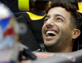 Red Bull driver Daniel Ricciardo of Australia smiles as he waits in his car during the third practice session for the Singapore Formula One Grand Prix on the Marina Bay City Circuit Singapore, Saturday, Sept. 17, 2016. (AP Photo/Wong Maye-E)